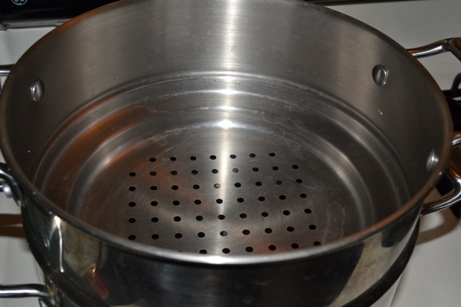 Close up of top pan with larger holes
