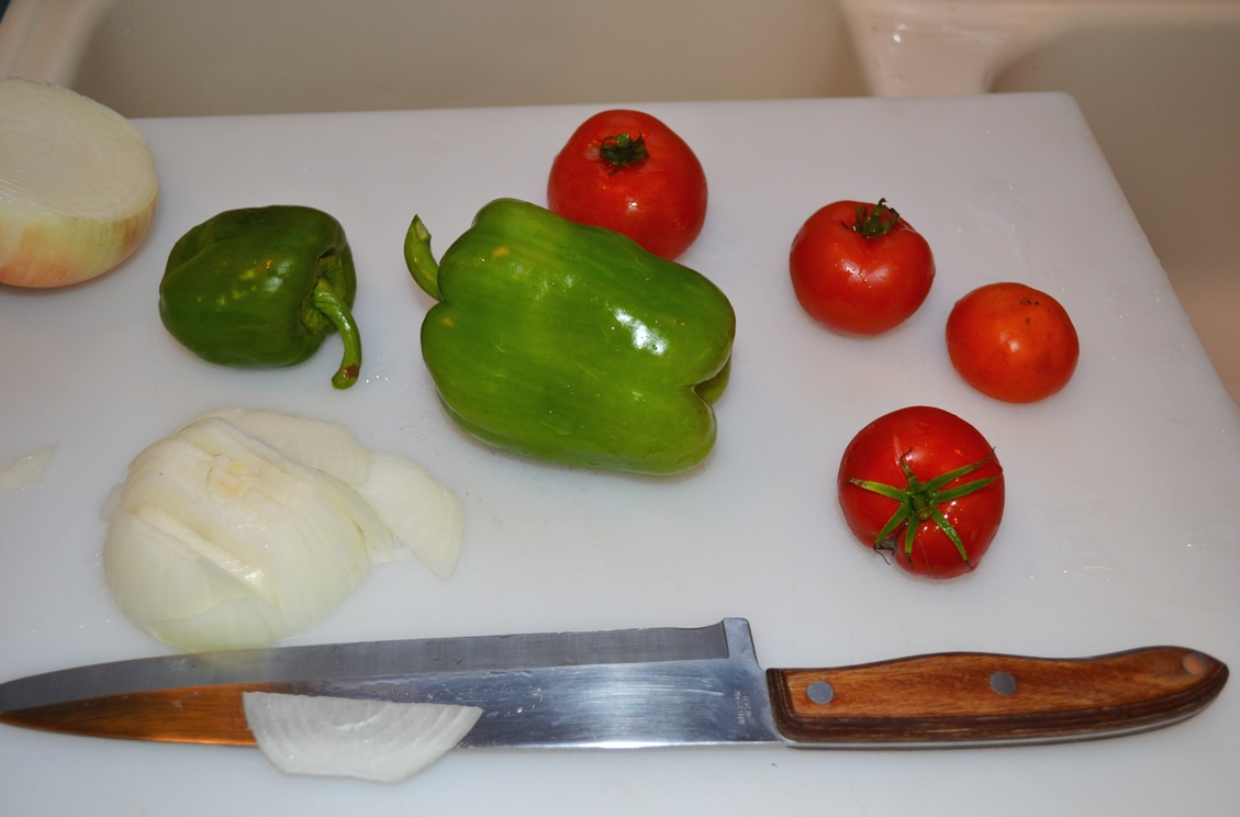Peppers Tomatoes and Onion on cutting board